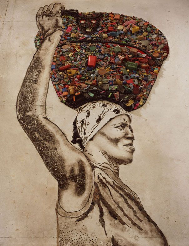 This is actually a giant potrait- made of recyclable materials and dirt by the people that are portrayed. Overseen by the artist Vic Muniz who himself started in a financially difficult situation. Do you have a dream?