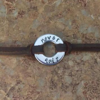 "Washer Bracelet - Hand stamped with ""never quit"" - Choice of band leather or waxed cotton cord"