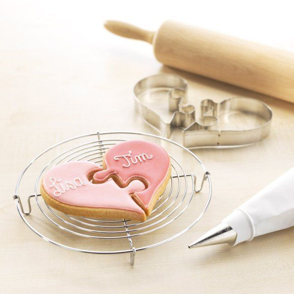 Two cookie cutters made of tinplate, in gift-box with recipe. This way hearts can not help merging: From two halves'll bake one whole, merged heart.