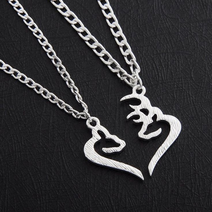 Buck & Doe Kissing Necklace These custom designed Buck & Doe Kissing Necklace are a MUST HAVE! Designed with premium high quality material.