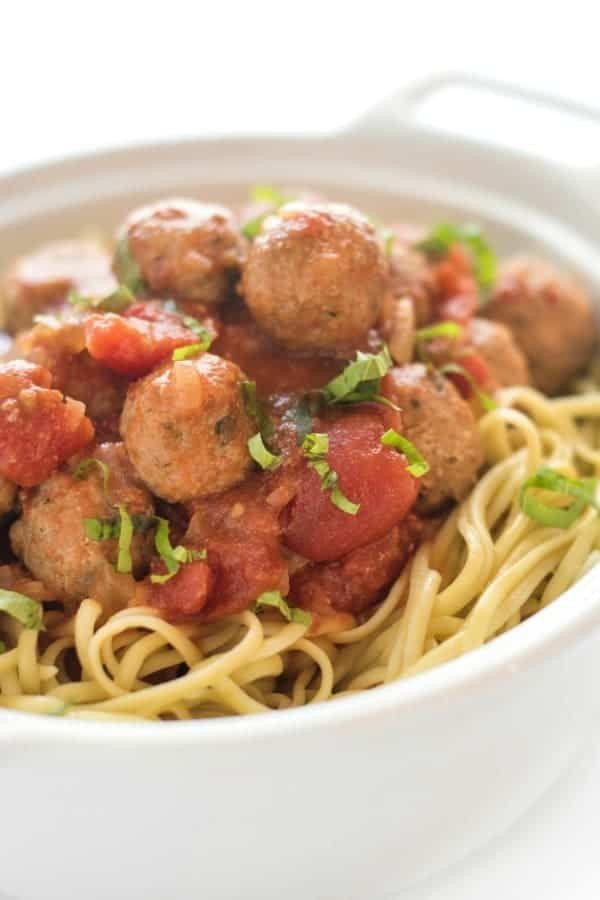 Turkey meatballs are slowly cooked in a homemade tomato basil marinara sauce until tender. Made without any breadcrumbs, this recipe is gluten free.