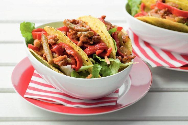 Kijk wat een lekker recept ik heb gevonden op Allerhande! Taco's met bonen gehaktsaus