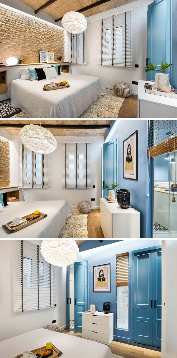 The calming palette in this modern bedroom features touches of blue to go along with the white, wood, and brick. A white pendant light above the bed brings in extra brightness and adds even more texture to the room. Blue doors and a narrow window connect the bedroom and allow the bathroom to as private or as public as you like.