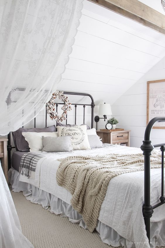 Rustic Farmhouse Bedroom - white plank walls, wood beams and a vintage bed - via Love Grows Wild