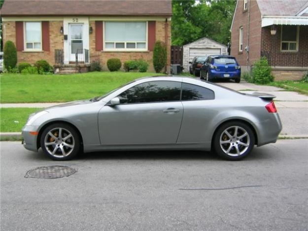 2003 Infinity G-35 coupe.  I loved my little sports car.  Thought I would get this before arthritis set in.  ha