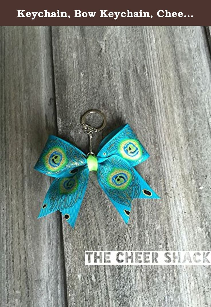 """Keychain, Bow Keychain, Cheer Bow Keychain. Peacock cheer bow keychain. 1.5"""" grosgrain ribbon. Embellished with The Cheer Shack's signature rhinestone. Great for decorating backpacks, bags, etc. Print design and color on each bow may vary."""
