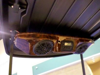 Golf cart radios can be installed overhead or in the dash.