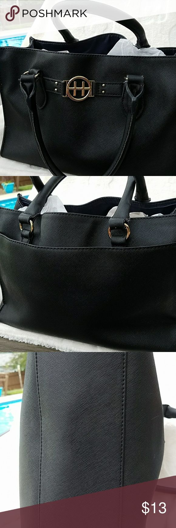 Tommy Hilfiger Black Tote Tommy Hilfiger Tote bag in black, with much sought after inside middle full length zipper pocket, 1 large inside pocket, zipper inside pocket. Used, but great condition, no stains, no tears, clean. From my own personal closet clean out. Tommy Hilfiger Bags Totes
