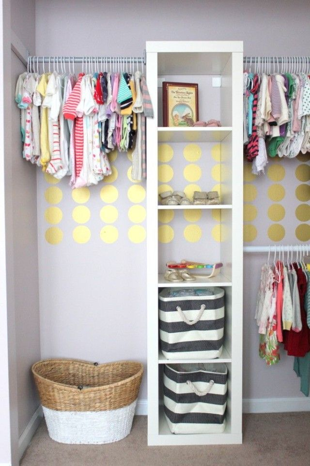 Design Idea: Don't forget to decorate the closet! These gold polka dots dress up a well-organized nursery closet. #nursery #closet