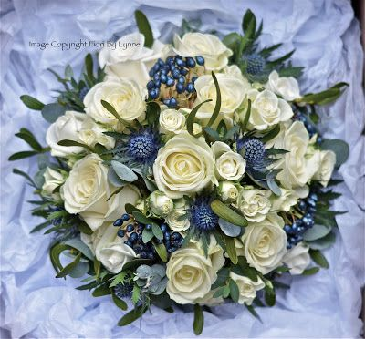 Bridal bouquet in ivory, navy blue and silver using roses, scottish thistles, midnight berries and eucalyptus