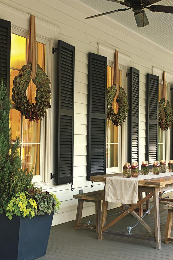Easy Entertainment - These Porches Got a Merry Makeover for the Holidays - Southernliving. This party-ready back porch serves as a cheerful spot for overflow party guests.