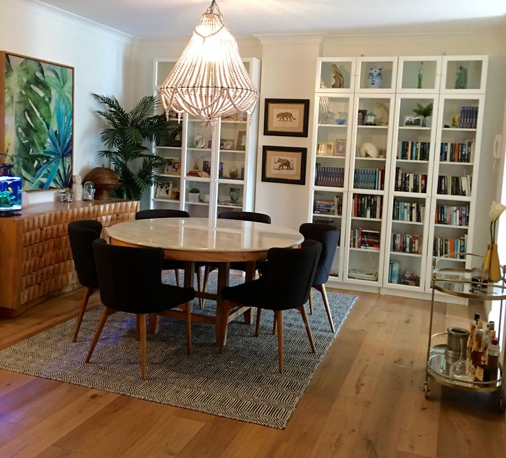 Dining Room In Swedish Crime Fiction Author AC Efvermans Sydney Home Marble Top Mango Wood BuffetBeaded ChandelierChandeliersIkea