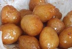 Egyptian Zalabia Balls. Heavenly dessert, eaten freshly fried and drizzled with syrup or sprinkled with powdered sugar.