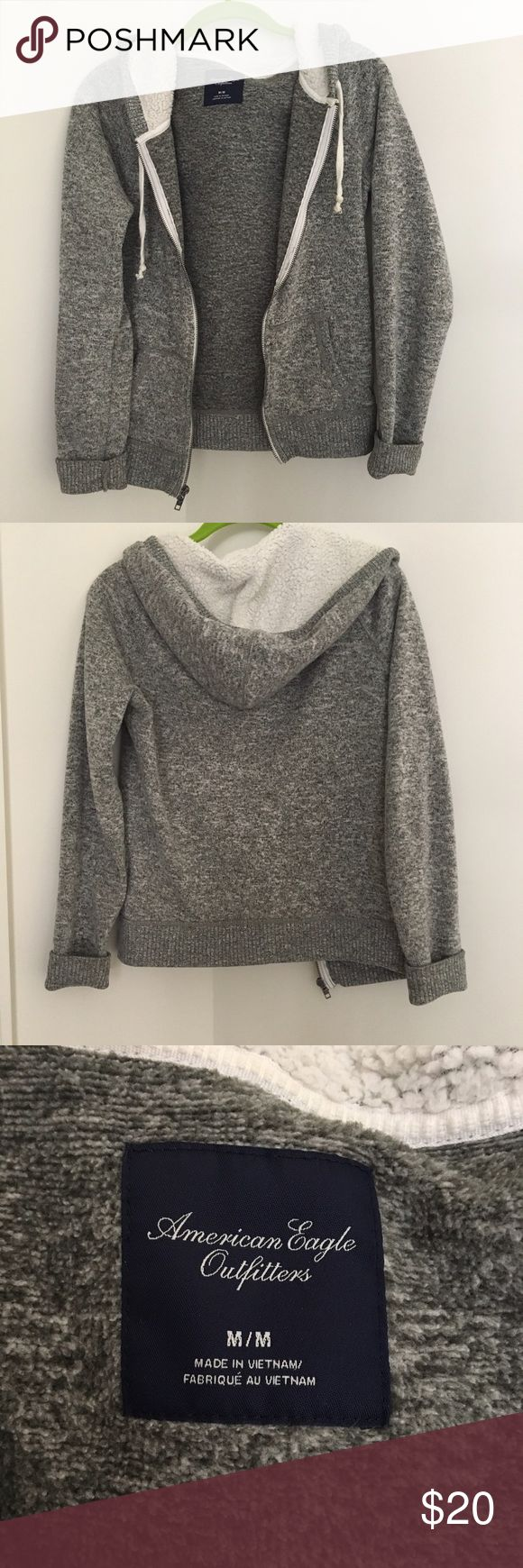 Gray American Eagle Zip-Up Hoodie ✧・゚: *✧・゚:*READ ME*:・゚✧*:・゚✧ 🌀 Super warm, cozy, and soft! No flaws, gently used, basically like new. Size medium but a little small for me (I like hoodies baggy) so I'd definitely say this runs true to size or small depending on your preferences.   ✧・゚: *✧・゚:*REMINDERS*:・゚✧*:・゚✧ 🌀 Please use the offer button, not the comments! 🌀 Ship same day except after 3pm EST 🌀 Smoke free home  🌀 Pet friendly home - no shedding!  🌀 What you see is what you get  🌀…