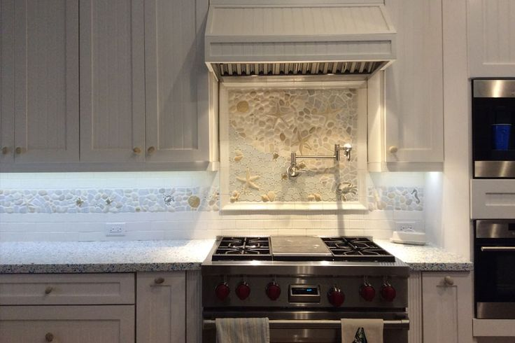 a large kitchen backsplash mural created with glass stone and ceramic pieces starfish crabs. Black Bedroom Furniture Sets. Home Design Ideas