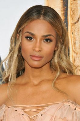 If you think your olive skin wouldn't fare well with blonde hair, test the waters with a warm caramel like Ciara's signature honey hair.