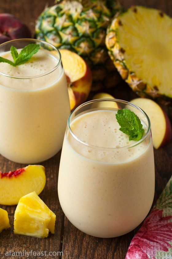 Pineapple Peach Smoothie Recipe - http://www.afamilyfeast.com - A light and delicious fresh pineapple peach smoothie made with non-fat Greek Yogurt and milk. So good!