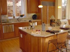 Charming Small Kitchen Islands with Seating and Storage also Giallo Ornamental Granite Countertops and Round Undermount Stainless Steel Sink from Kitchen Island Plans