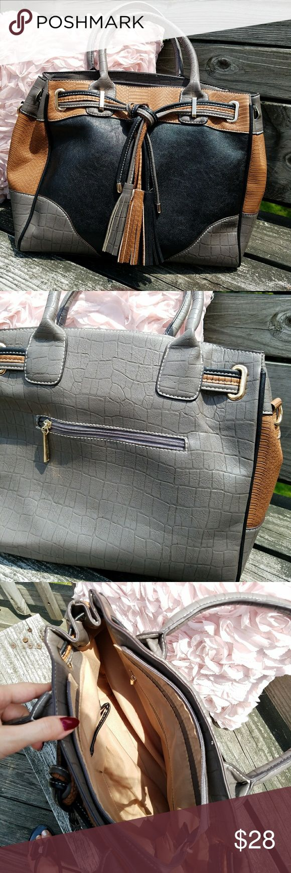 3 Color Tote New without tags!  Gorgeous embossed faux leather with tassel detail.  3 color bag with gray, black, and cognac.  Purchased from Marks and Spencer in England. Marks & Spencer Bags