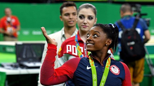 Aug 11, 2016; Rio de Janeiro, Brazil; Simone Biles (USA) celebrates winning the gold medal during the women's individual all-around final in the Rio 2016 Summer Olympic Games at Rio Olympic