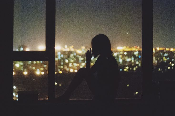 (by Angela W) She likes to sit and watch the city at night. It is calm and peaceful and a good place to relax while her injuries heal. She is often joined with a bottle of alcohol