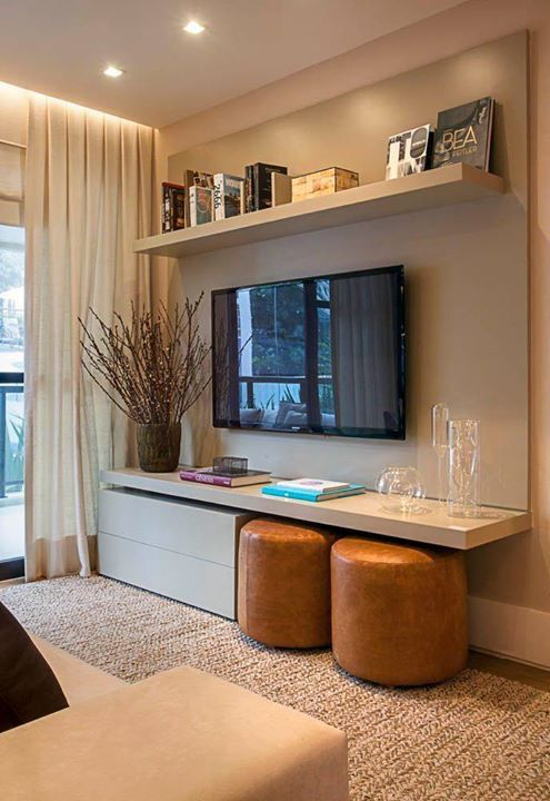 Wall mount television above simple storage/ seating