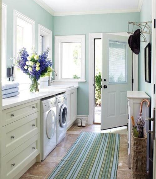 Lovely sunroom laundry room...awesome color! #laundryroom