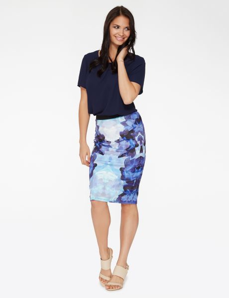 Great for work or play, this pencil skirt is made from a scuba knit fabric. It features a blue tone floral print with a contrasting  black elasticated waistband. #NewandNow