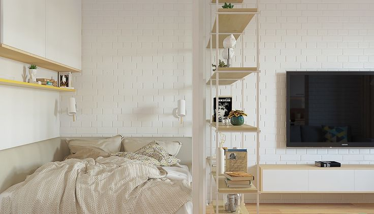 Textured white walls personalise both spaces. Minimalist bedding lies behind a two-walled entrance, one sketched in abstract, the other clad in white brick. Scandinavian school chairs offer a view.