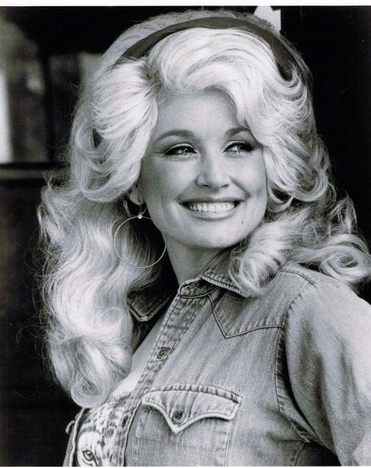 Dolly knows a genuine smile is a lady's best accessory. But big hoop earrings don't hurt.