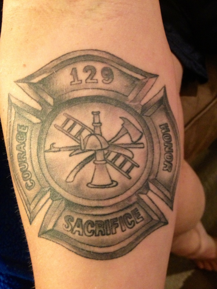 Maltese cross tattoo, right forearm done by twizted images.