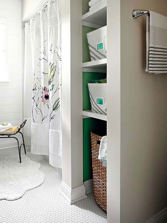 Open shelving, and pops of color on the inside of the shelves to match the colors in the shower curtain.