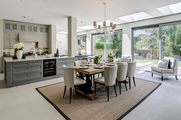 Stylish dining area in open plan kitchen we won best for Top british interior designers