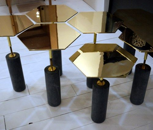 mini tables from Egg Collective. They adjust higher or lower by turning them.