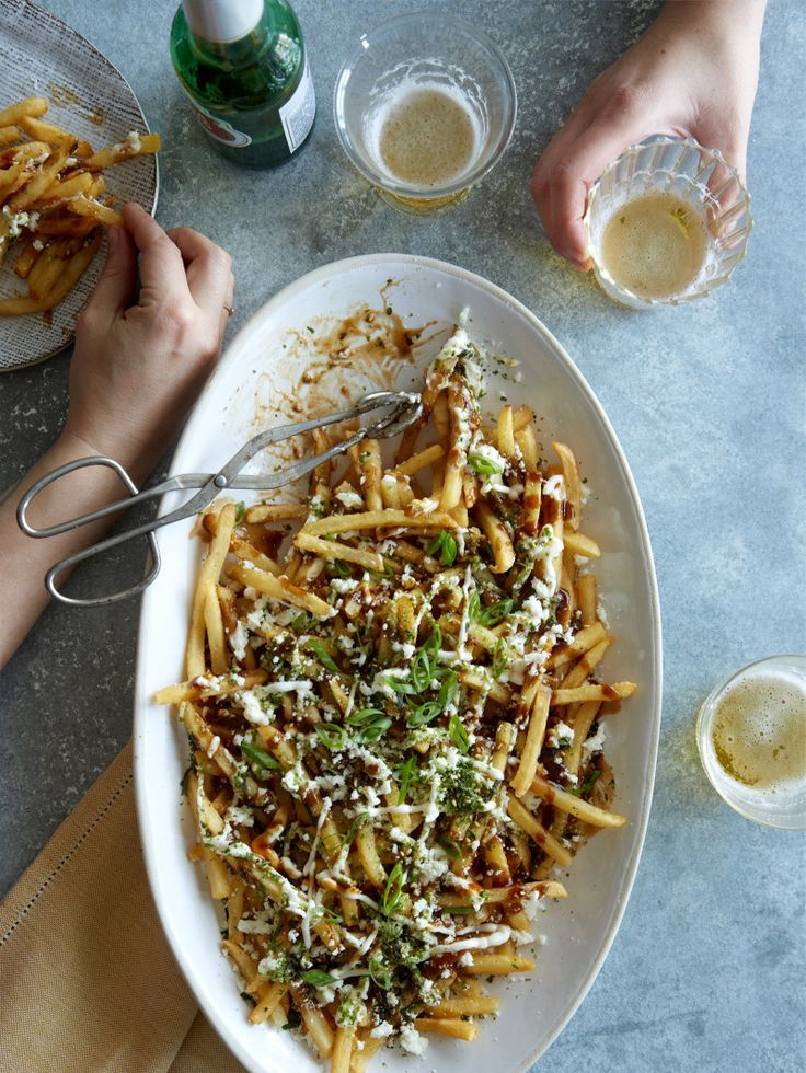 Okonomoyaki Fries Makes 1 pound Ingredients: 1 pound frozen (store bought) French fries katsu sauce kewpie or mayonnaise (from a squeeze bottle) furikake seasoning bonito flakes, optional green onions, thinly sliced
