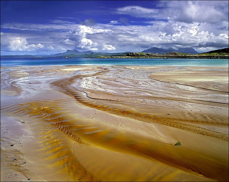 Brine Junction ~ the lurid colors of rivulets from a peat stream flowing over the red sandy beach of Mellon Udrigle on the northwest coast of Scotland  Photo ~ Ian Cameron