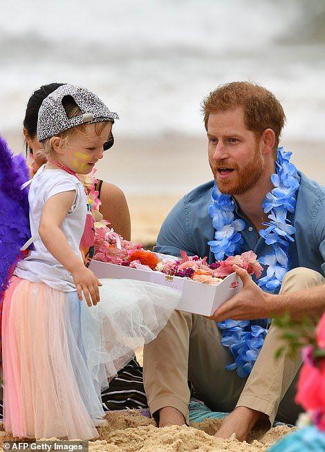 4a46e4a01 ... kick off shoes on beach. Prince Harry meets a tiny surfer chick on Bondi  Beach on Friday