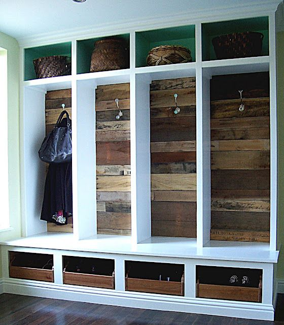 bringing on the old with the new in this cute coat closet using what else? pallets for the back! LOVE