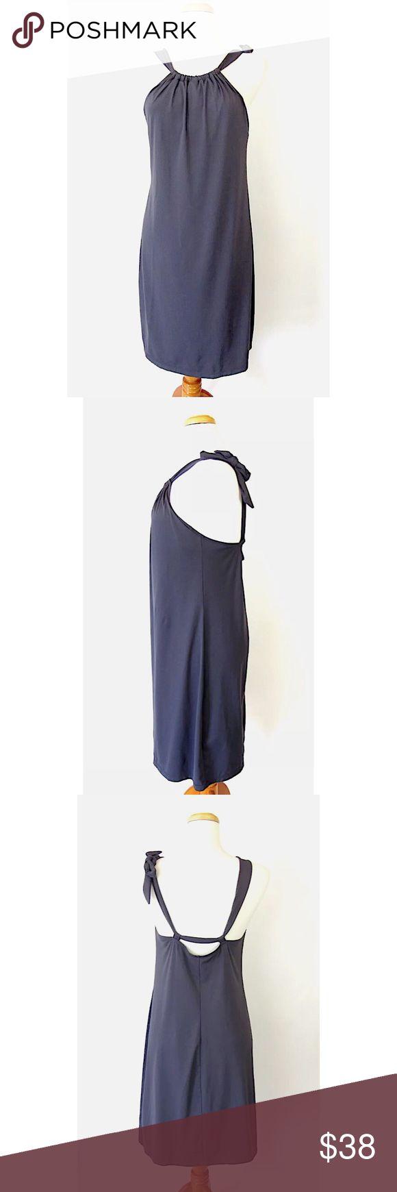 "Athleta Kokomo Dress Charcoal Gray Swim Sz L Brand: Athleta Style:  Kokomo: Adjustable Strap Beach/Swim Dress, Built in Shelf Bra Size:  Large Color/Pattern: Charcoal Gray Material:  75% Nylon, 25% Spandex Measurements taken flat:   -Across under arm: 17"" -Shoulder to hem: 42"" Care Instructions: Machine wash, line dry  Condition: No flaws. See pictures for details. Athleta Dresses Midi"