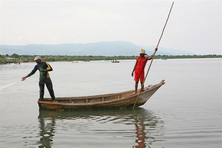 Fishermen in Kasenyi, DRC, throw a net to trap fish on Lake Albert