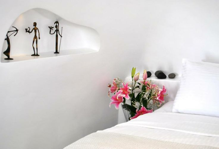 Romantic bedroom at Aspaki Exclusive Suites in Oia. Ideal for lovebirds.