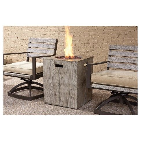 Enjoy the rustic warmth and enduring performance of the Peachstone outdoor fire table. The square compact design has all the appearances of richly grained wood, but is actually a carefree all-weather composite you'll enjoy gathering around for years. Included burner cover transforms the fire table into a convenient end table. Signature Design by Ashley is a registered trademark of Ashley Furniture Industries, Inc.