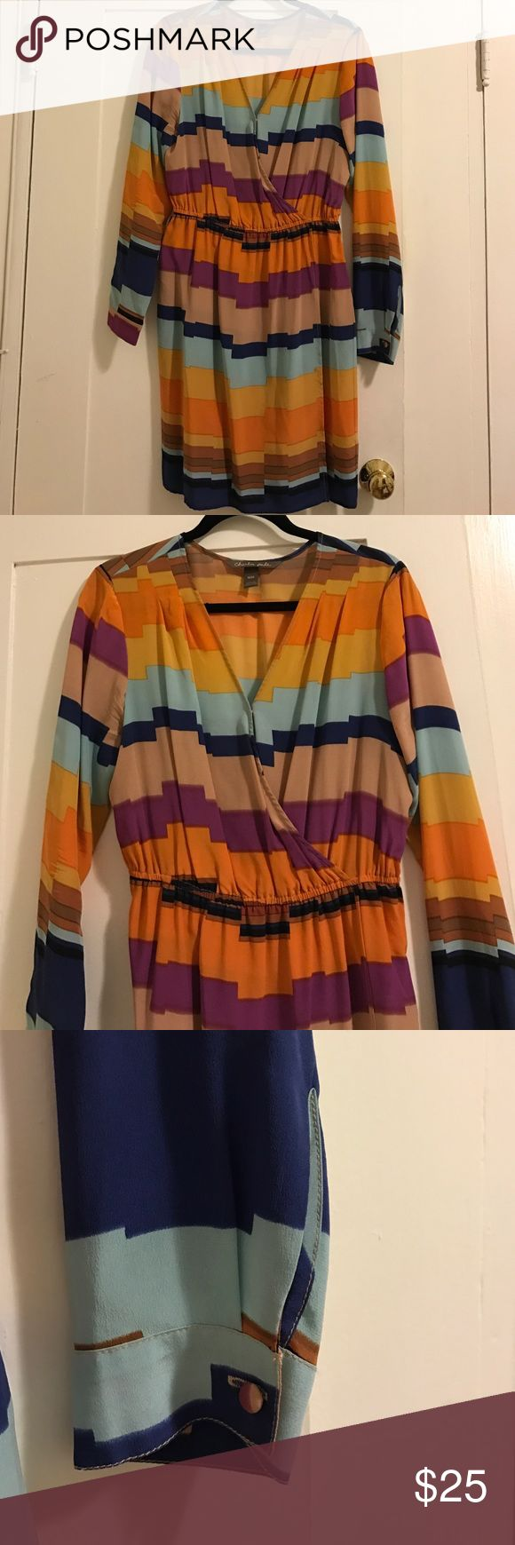 Multicolor Charlie Jade Slit Dress Multicolor Charlie Jade long sleeve slit dress with a V neckline. It is 100% silk. Outfit pairs perfectly with. Nude heels or sandals. Dresses Long Sleeve