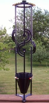 Aeolian harp.. the wind plays across the strings and makes beautiful music.