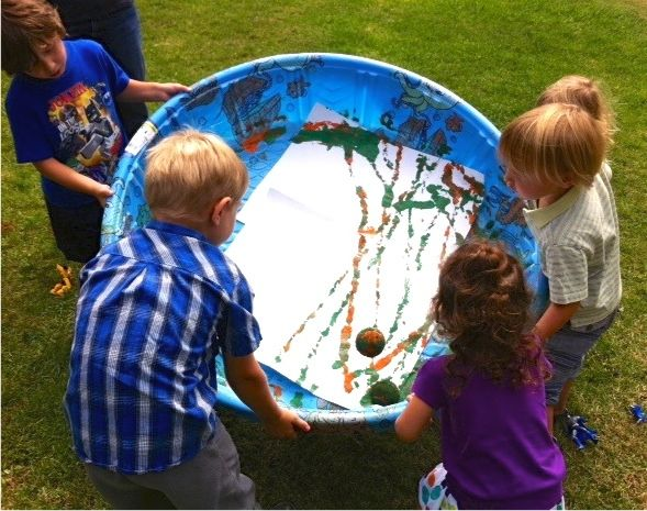 Tennis ball painting! Place a tennis ball in a kiddie pool along with paint and a large piece of paper and see what kind of art you can create. Add a tactile element to your artwork with puffy paint or add sand to your paint.