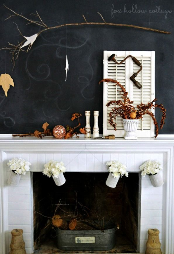 I stinking love this tin can garland! Oh the create it is flowing Fall Fireplace Mantel Chalkboard Wall