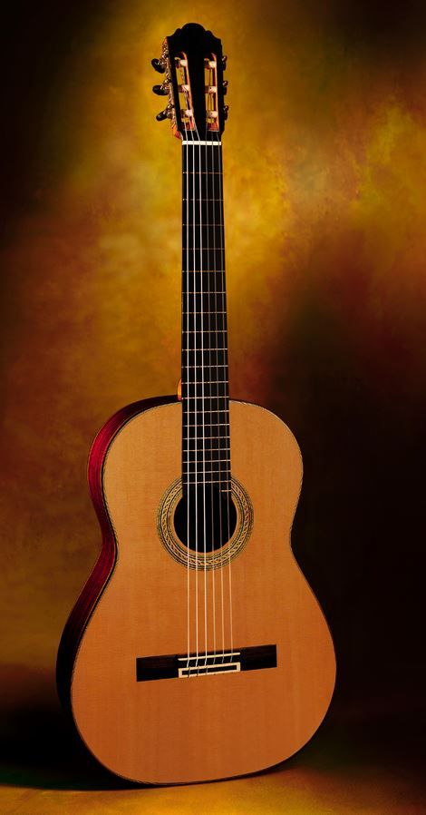 Daniele Chiesa, Spain Concert Classical Guitar Model Ind./ced. New 2016 $9,500.00 Inquire Here: 216.752.7502 Very dark (nearly black) Ind. sides and back, master grade western red cedar soundboard, one of the silkiest most elegant looking side grain mosaic rosettes we have seen, 12 hole tie block system, beautifully executed French polish of shellac finish, Alessi machine heads featuring Chiesa's proprietary head stock design and ebony oval buttons, meticulous workmanship throughout, 650mm…