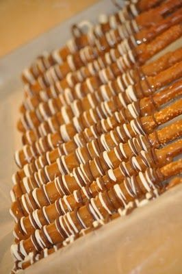 Caramel Chocolate Pretzel Rods recipe from The Hungry Mama  //  For more yummy recipes, give us a follow on Facebook or