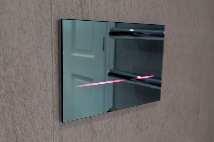 Flush In Style. Touchless flush plate with LED colour light (pink or blue) the flush is activated when it detects movement. Copyright The Designer Knowledge. Photo by Ani Evans Photography.