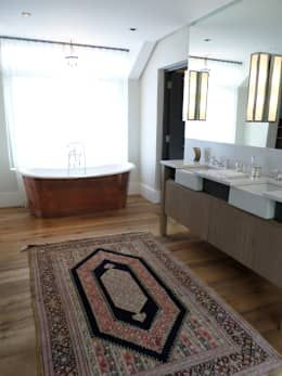 master bathroom with a rug eclectic bathroom by claire cartner interior design